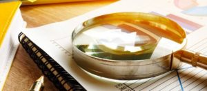 image of a magnifying glass on paper